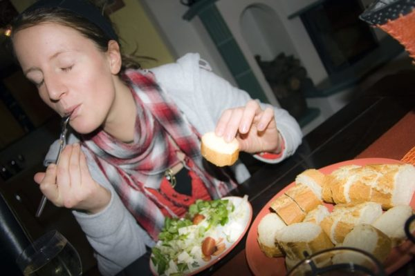 Woman eating food and laughing